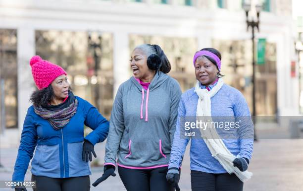 Mature African-American women in city, walking, talking