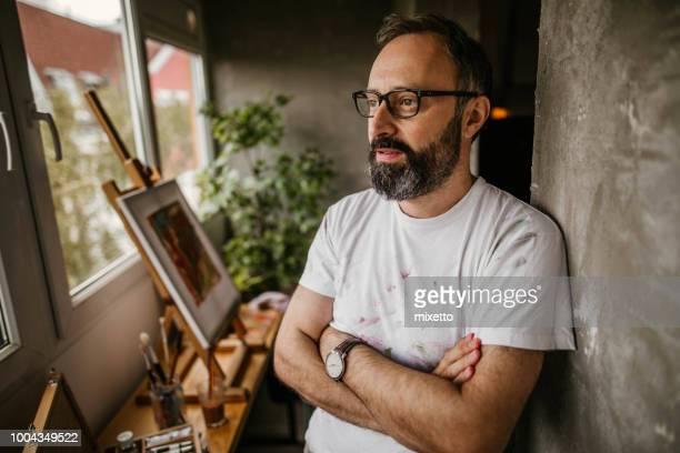 Mature artist on his art studio