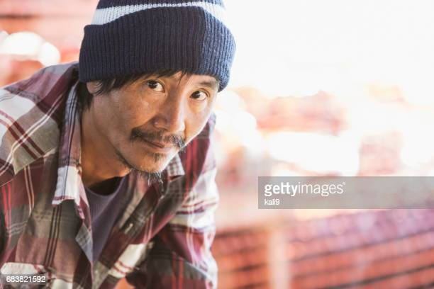 Mature Asian man working in produce market