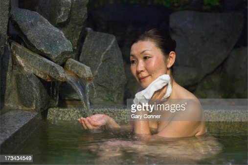 Mature Asian Woman Bathing Stock Photo  Getty Images-5517