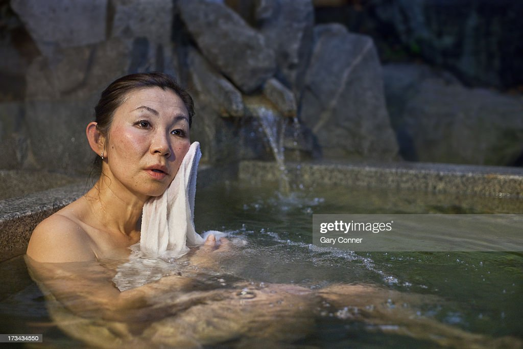 Mature Asian Woman Bathing Stock Photo  Getty Images-7878