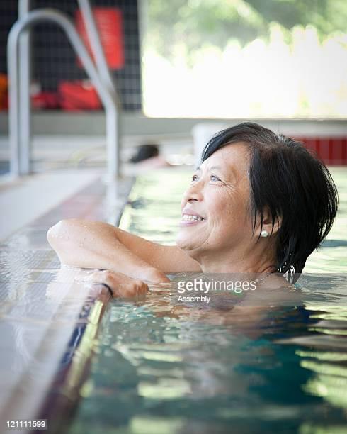 Mature Asian woman in pool
