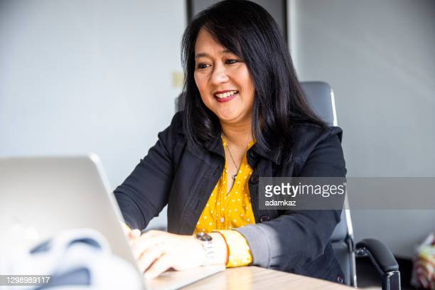 mature asian woman working - launch event stock pictures, royalty-free photos & images