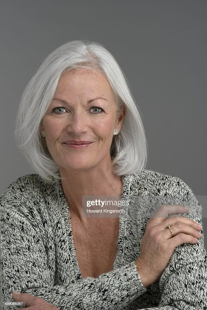 Mature Attractive Woman Smiling To Cam Stock Photo - Getty -6635