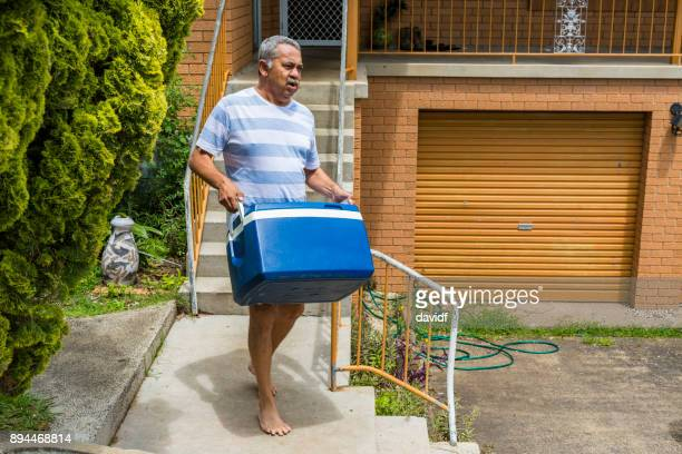 Mature Australian Aboriginal Man Preparing to Pack the Car for a BBQ
