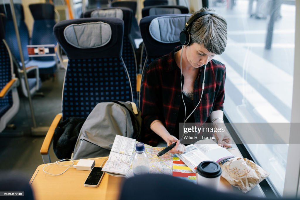 Mature Backpacker Organizing Her Travel Plans : Stock Photo