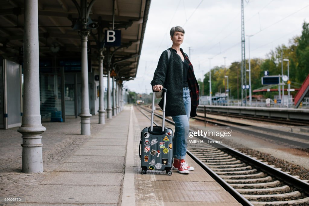 Mature Backpacker Waiting For Train On Station Platform : Stock-Foto