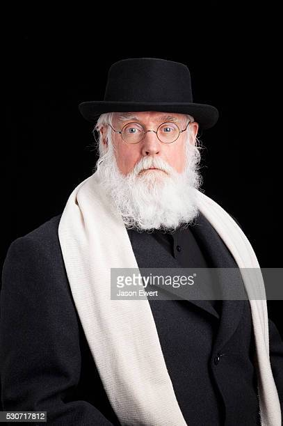 mature bearded jewish man wearing spectacles, hat, overcoat and a scarf; alberta, canada - jewish man stock photos and pictures