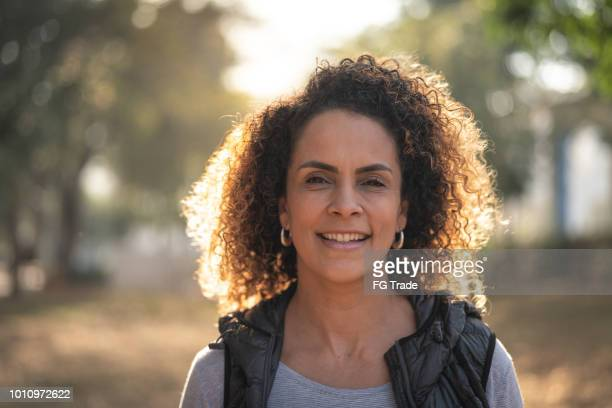 mature beautiful curly hair woman looking at camera - brasil stock pictures, royalty-free photos & images