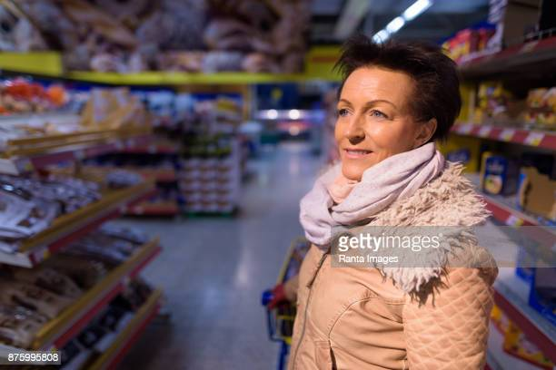 Mature beautiful woman shopping at the grocery store