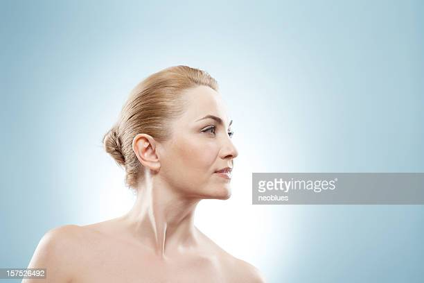 mature beauty looking into the corner. - overexposed stock pictures, royalty-free photos & images