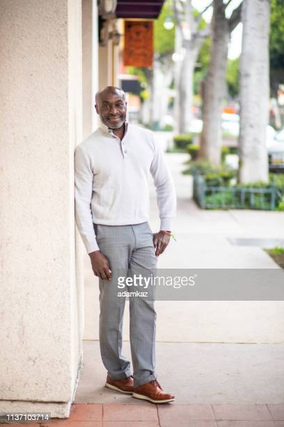 Mature Black Businessman on Street