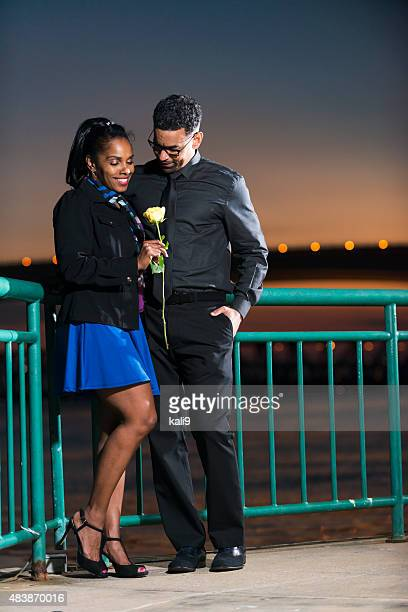 mature black couple on date night, with yellow rose - kali rose stock pictures, royalty-free photos & images