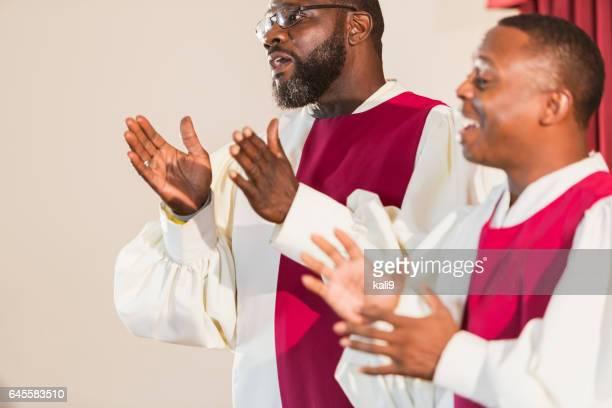 mature black men singing gospel music in church choir - gospel stock pictures, royalty-free photos & images