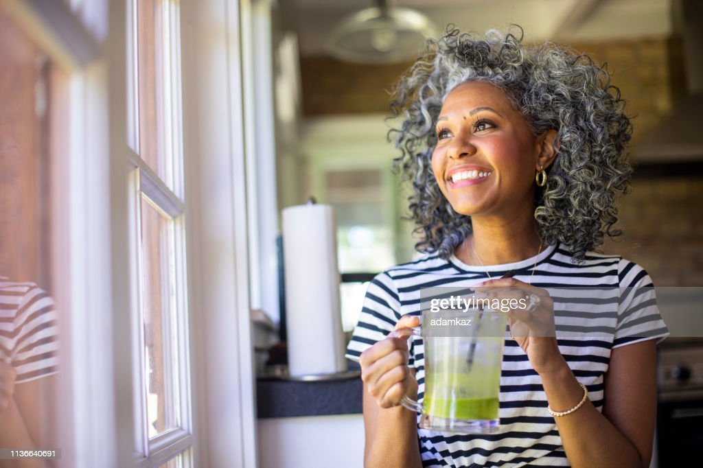 Mature Black Woman Drinking a Green Smoothie : Stock Photo