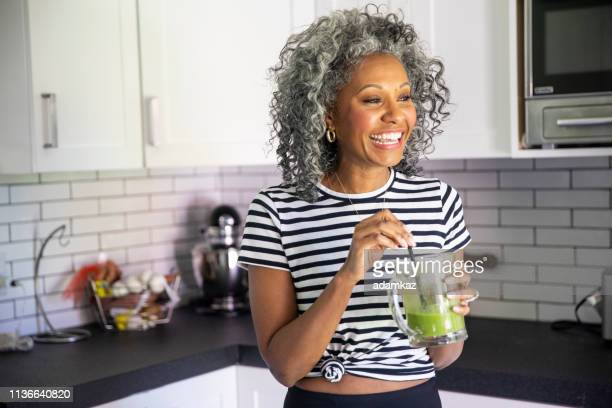 Mature Black Woman Drinking a Green Smoothie