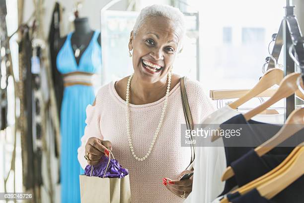 Mature black woman shopping in a clothing store