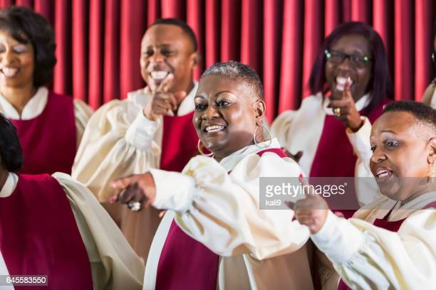 mature black women and men singing in church choir - gospel stock photos and pictures