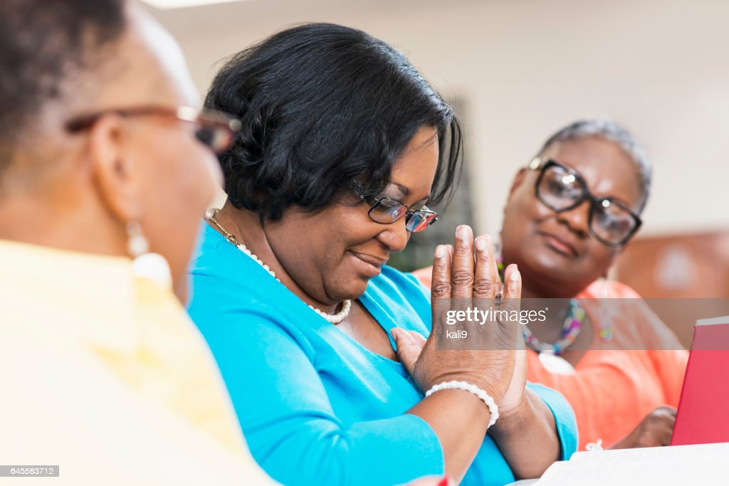 Mature Black Women With Friends Praying In Bible Study
