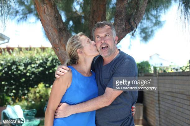 Mature blond lady kissing her husband