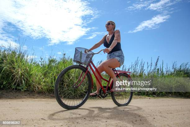 Mature blond lady on bicycle