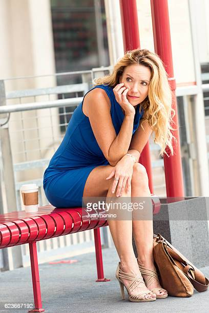 Mature blond woman waiting for the bus
