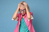 european mature blonde woman glasses expressing