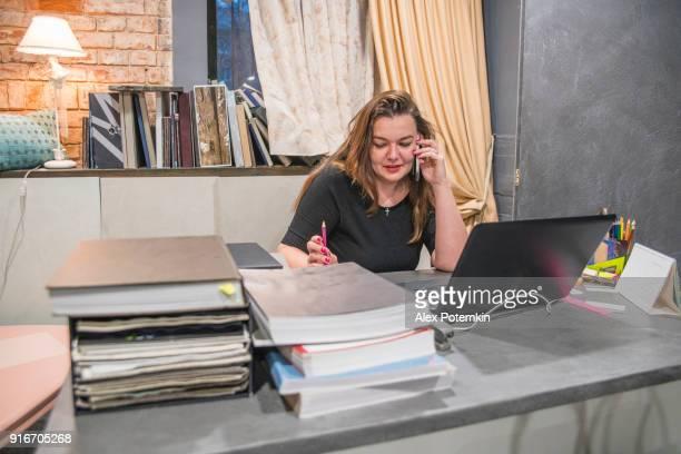 Mature, body positive businesswoman, small business owner, working in the office