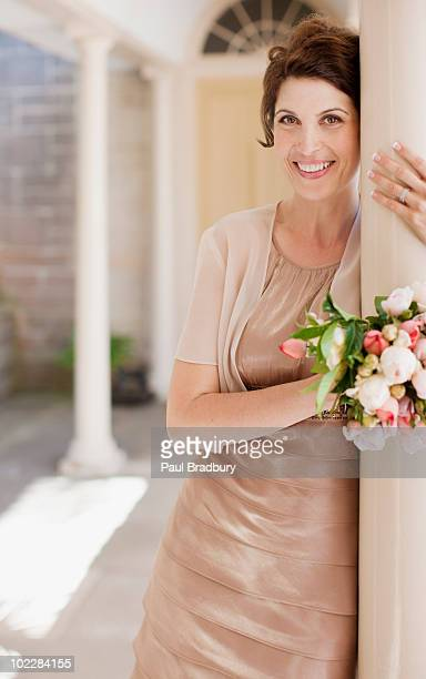 Mature bride holding bouquet