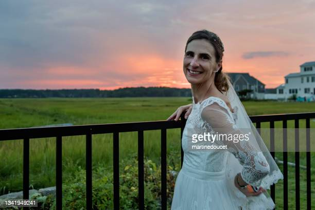 """mature bride portrait at sunset in backyard. - """"martine doucet"""" or martinedoucet stock pictures, royalty-free photos & images"""