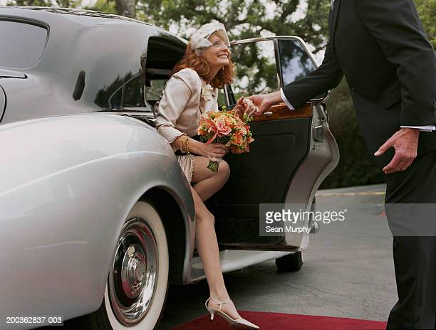 Mature bride stepping out of car