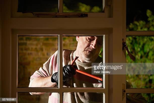 Mature burglar