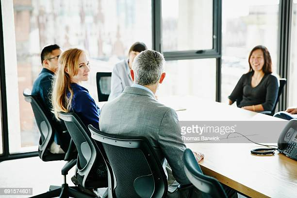 Mature business executive leading meeting