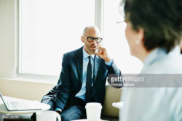 Mature business executive listening during meeting