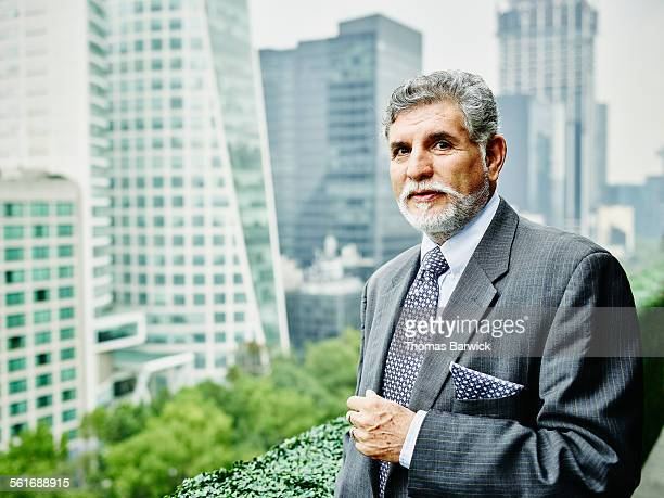 Mature business executive standing on office deck