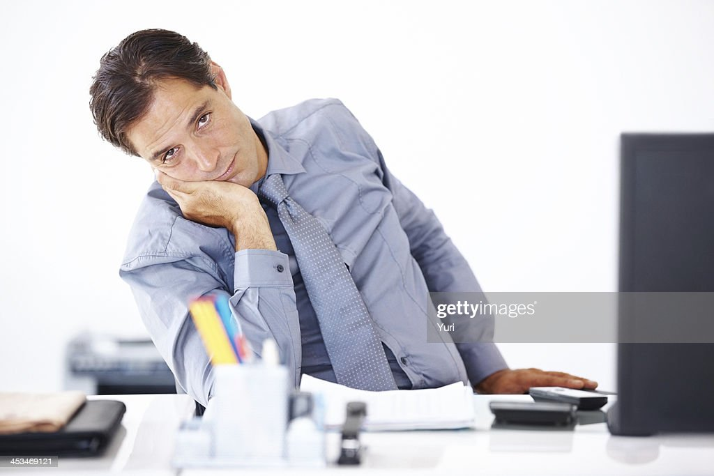 Mature business man getting bored at work : Stock Photo