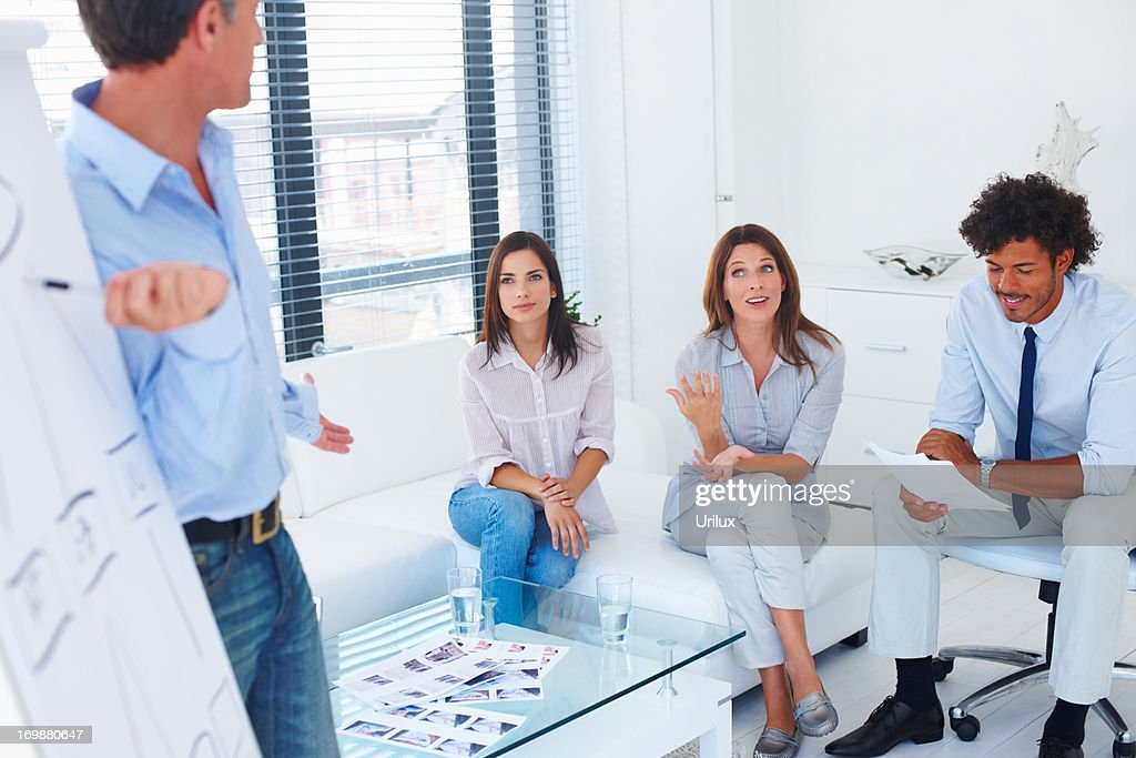 Mature Business Man Giving A Presentation To His Associates
