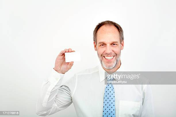Mature business man holding a blank card