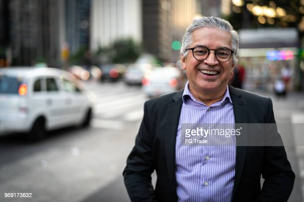 mature business man portrait on sao paulo, brazil - iberian ethnicity stock pictures, royalty-free photos & images