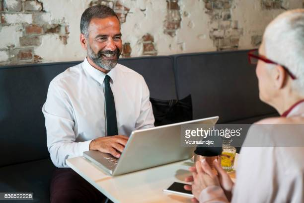 Mature business people at restaurant