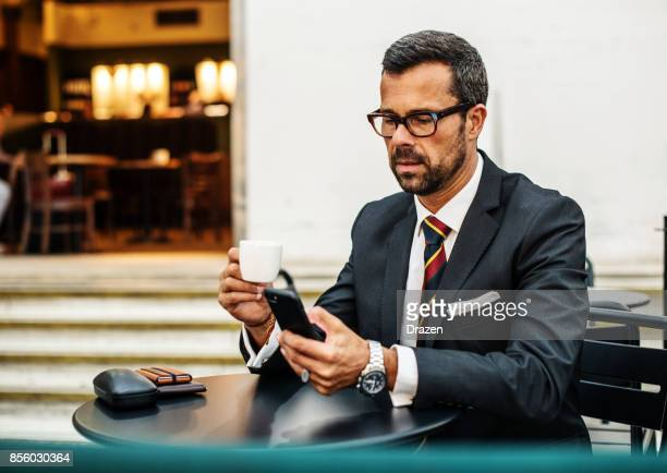 Mature business person drinking espresso while waiting for the flight