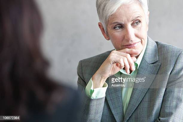 mature business woman in meeting