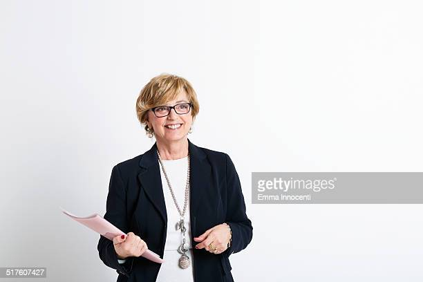 mature business woman with black suit jacket - waist up stock pictures, royalty-free photos & images