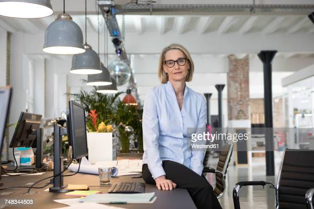Mature business woman working in office