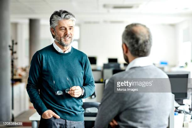 mature businessman discussing with entrepreneur - employee engagement stock pictures, royalty-free photos & images
