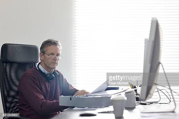 Mature businessman going through documents