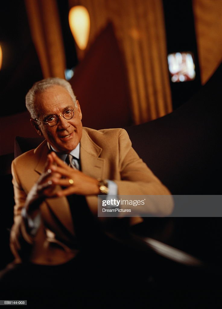 Mature businessman having conversation at table : Stock Photo