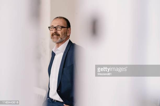 mature businessman in a cafe - differential focus stock-fotos und bilder