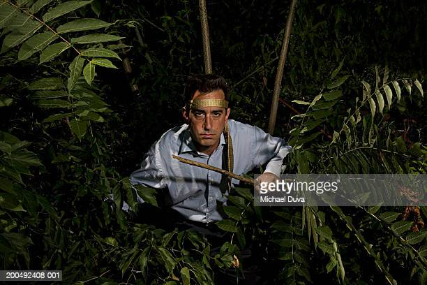 mature businessman in jungle, portrait - hair band stock pictures, royalty-free photos & images
