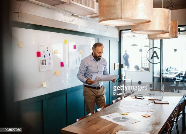 mature businessman in smart casual clothes in meeting room - smart casual stock pictures, royalty-free photos & images